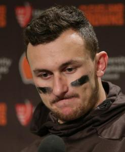Cleveland Browns quarterback Johnny Manziel speaks with media members following the team's 30-13 loss to the Seattle Seahawks n an NFL football game, Sunday, Dec. 20, 2015, in Seattle. Credit: AP Photo/Scott Eklund