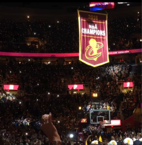 The Cavs championship banner heads to the rafters of Quicken Loans Arena on October 25. Photo Credit-Jeff Lansky